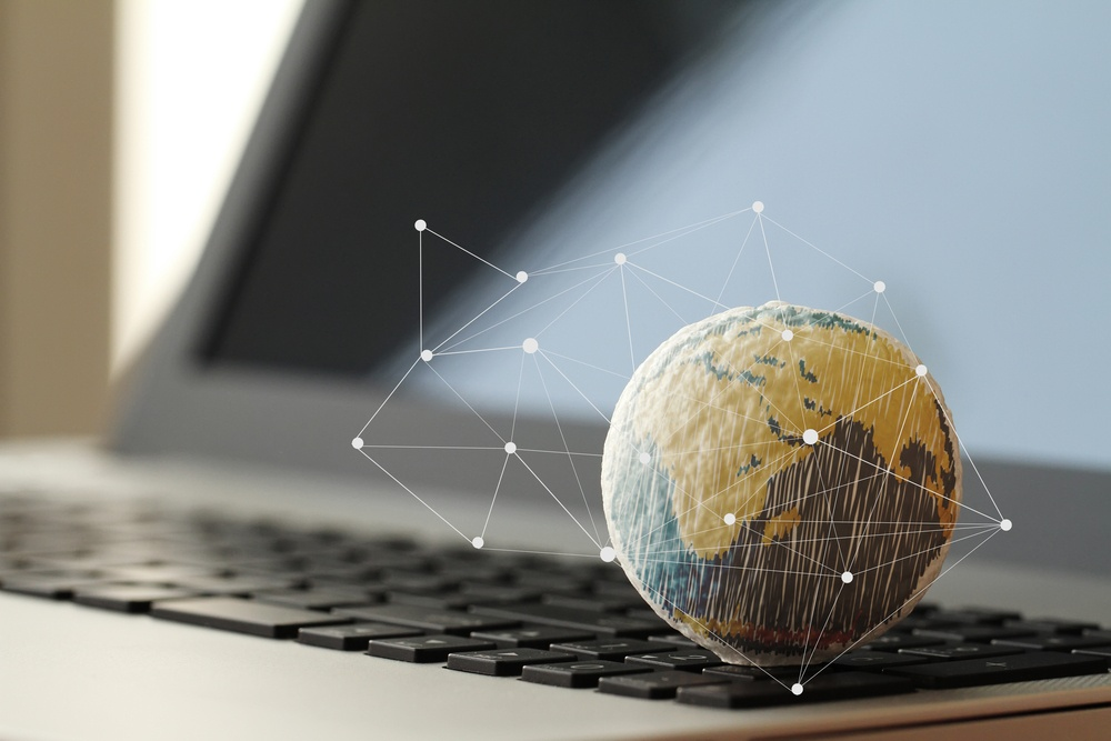 hand drawn texture globe with social media diagram on laptop computer as internet concept.jpeg